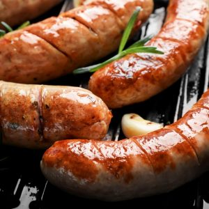 Grill pan with delicious grilled sausages, close up